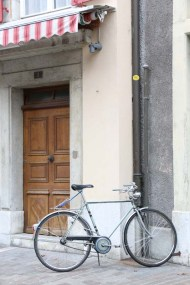 Bike parked at a wooden door in solothurn