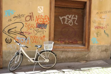 Bike parked at a graffiti wall in solothurn