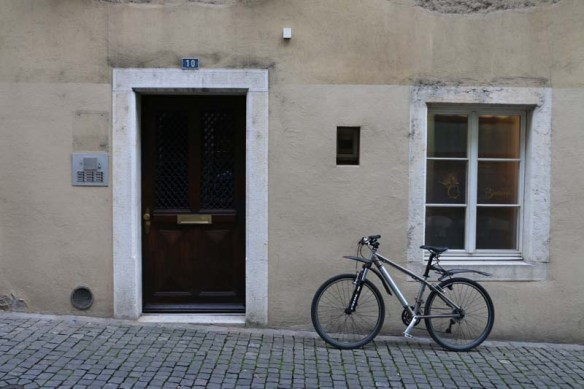 Bike parked at a beige wall building in solothurn