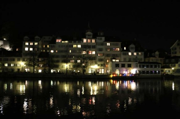 A photograph of Zurich colorful lights reflecting on Lake Zurich