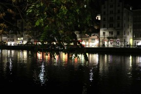 A photograph of Lake Zurich at night