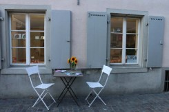 2 Seaters white chairs sunflower and a romantic date in the streets of Zurich
