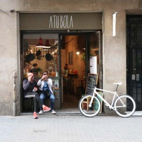 A nice cute shop with a beautiful white bicycle