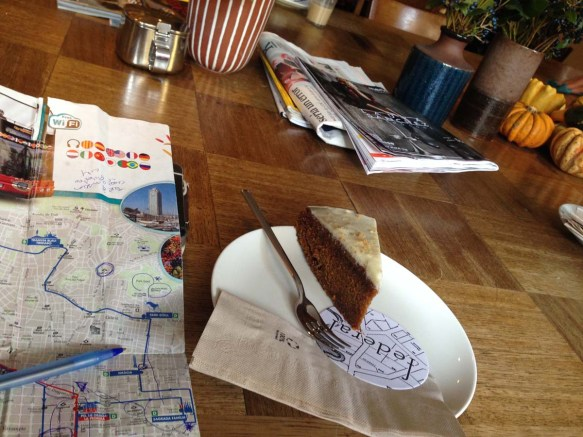 Carrot cake map camera and a coffee