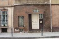 Brown old door and house in Barcelona