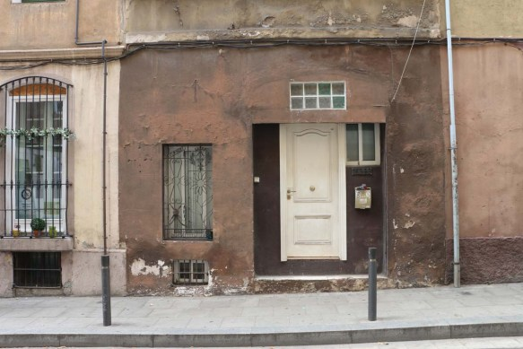 Brown old door and house in Barcelona