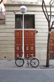 Brown door with bicycle in Barcelona