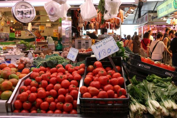Big open market in Barcelona selling tomatoes