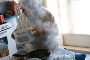 A woman from Nablus making food for guests