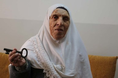 An old Palestinian woman hoping to return to her occupied home one day